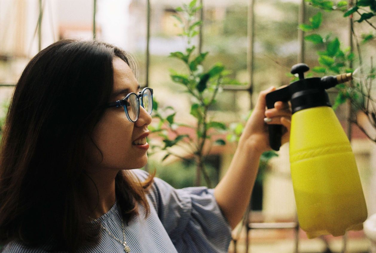 woman misting her plants