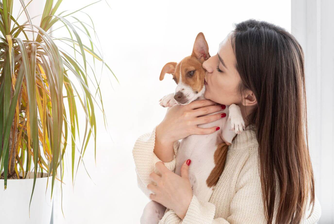 woman and dog in front of spider plant
